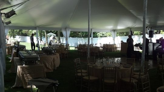 tables set up with pole covers on tent legs