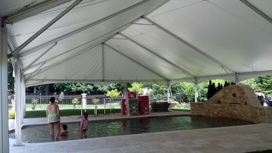 engagement party with tent over pool
