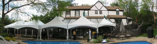 High Peak Frame Tents Around A Pool