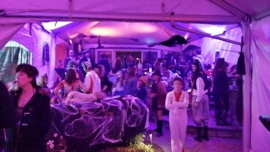 halloween party in tents over raised pool floor